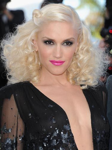 """Gwen Stefani isn't known for holding back. Here, she really went for it with big curls, inky eyes and bold lips. Create a toned-down version of her eye-lip combo with black liquid liner and a lip color like <a href=""""http://www.lorealparisusa.com/_us/_en/default.aspx#/?page=top{userdata//d+d//