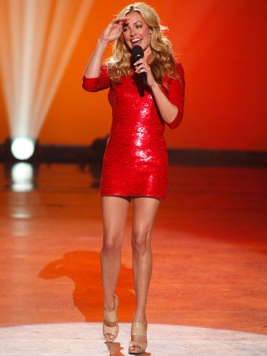 For the show's finale, Cat showed some leg in a crimson, sequined mini.
