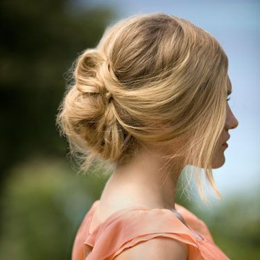 "You know how you twist your hair when you're bored on a lazy day? That's the key trick to this style, according to NYC stylist Leon Gorman, who created the looks seen here. Make a low side ponytail, leaving a few pieces loose around your face. Twist the length of your ponytail, and wrap it into a figure-eight shape — smoosh it up against your scalp, and tuck the ends into the loop. Insert a few hairpins or tiny barrettes to lock it all in place. Finish with a mist of lightweight hair spray that'll give you extra hold minus any stickiness. We like <a href=""http://www.paulmitchell.com/Products/PaulMitchell/ExpressStyle/Pages/WorkedUp.aspx"" target=""_blank"">Paul Mitchell Worked Up</a>, $14.95."