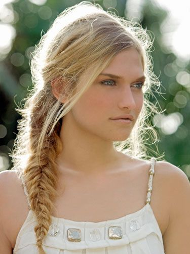 """This is the perfect style to rock if you're hanging out by the shore, since the salty air will give your strands great texture for braiding, says Gorman. If you're not near the beach, you can fake that texture by misting a sea-salt spray through damp strands (a good one: <a href=""""http://www.db4wildaid.com/product.aspx?id=95"""" target=""""_blank"""">David Babaii for WildAid Bohemian Beach Spray</a>, $9.95) and letting hair air-dry. Then do a fishtail braid: Divide your hair in half, and hold the left side in your left hand and right side in your right hand. Pull a half-inch section of hair from the outside of the right side and add it to the inside of the left side. Repeat with a piece from the outside of the left side, adding it to the inside of the right side. Continue adding half-inch pieces down to your ends, and secure with an elastic. Position the braid over your shoulder, then tug out a few pieces around your face for a breezy effect (or just let the wind do its thing)."""