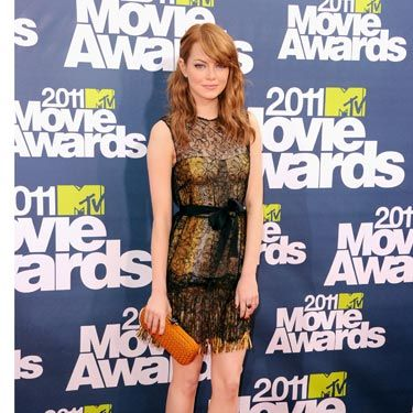 "Emma Stone ditched her <a href=""http://www.cosmopolitan.com/hairstyles-beauty/beauty-blog/emma-stone-new-blonde-hair"">""natural"" blonde mane</a> and went back to her trademark auburn. This seriously sexy, black lace and gold fringe cocktail dress by Bottega Veneta really worked with the new hue."