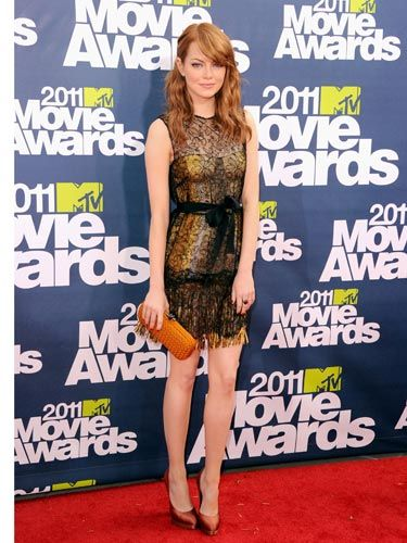 """Emma Stone ditched her <a href=""""http://www.cosmopolitan.com/hairstyles-beauty/beauty-blog/emma-stone-new-blonde-hair"""">""""natural"""" blonde mane</a> and went back to her trademark auburn. This seriously sexy, black lace and gold fringe cocktail dress by Bottega Veneta really worked with the new hue."""