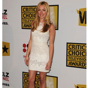 There are a million reasons a white, lace dress is a brilliant buy: It never goes out of style, you can dress it up or dress it down, it's sexy but still demure...the list goes on. Opt for shoes that complement the dress, but aren't too matchy—white on white is a bad idea here. Cat Deeley gets it right with a great T-strap heel.