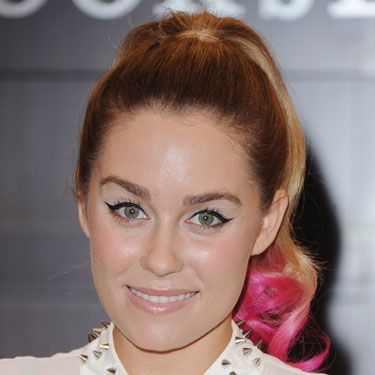"""<p>LC recently jumped on the bright-pink-hair bandwagon an hour before her book signing for <em>The Fame Game</em>. Lauren later said in an interview that she wanted something that would offset her edgy, rocker-chic collar with """"girly-ness,"""" so her hairstylist, Kristen Ess, dipped her ponytail tip in semi-permanent color in the kitchen sink. Ess also joked that Lauren is """"Fuchsia Barbie.""""</p>"""