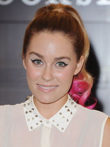 "<p>LC recently jumped on the bright-pink-hair bandwagon an hour before her book signing for <em>The Fame Game</em>. Lauren later said in an interview that she wanted something that would offset her edgy, rocker-chic collar with ""girly-ness,"" so her hairstylist, Kristen Ess, dipped her ponytail tip in semi-permanent color in the kitchen sink. Ess also joked that Lauren is ""Fuchsia Barbie.""</p>"