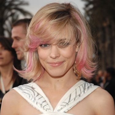 "This A-lister can do no wrong in our eyes, so when she stepped out with pink pieces of hair framing her face we totally embraced it. The not-too-bright hue also complemented <a href=""http://www.cosmopolitan.com/hairstyles-beauty/hair-care/best-blonde-hair-color""target=""_blank"">