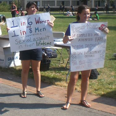"""The Undergraduate Student Government printed matching t-shirts saying 'Sexual Assault Awareness Day' (including the number for the Boston College 24/7 hotline), stood in the most trafficked area of campus, held up signs with statistics, and handed out information to passersby. Many students signed up for important programs like Bystander Education Student Trainers (BEST) and SANet. Our Boston College Police Department was on hand with whistles, magnets, and registration for the Rape Aggression Defense Program."" - Alicia Johnson"