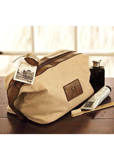"""The brown leather and canvas combo will make Dad feel like he's in the Outback, even if he's just lugging this bag on a business trip to Cleveland. <br /><br /> Pottery Barn Saddle Dopp Kit, $39, <a href=""""http://www.potterybarn.com/products/saddle-leather-canvas-dopp-kit/""""target=""""_blank"""">potterybarn.com</a>"""