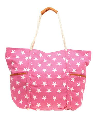 "If red, white and blue isn't your thing, try pink! Not only is the print awesome, this roomy tote is perfect for lugging around beach essentials.  <br /><br /> Oversized Canvas Shopper, $20.69, <a href=""http://us.asos.com/ASOS-ASOS-Oversized-Canvas-Shopper/vzuyh/?iid=1505964&SearchQuery=stars&Rf-700=1000&sh=0&pge=0&pgesize=200&sort=-1&clr=Fuschiastar&mporgp=L0Fzb3MvQXNvcy1PdmVyc2l6ZWQtQ2FudmFzLVNob3BwZXIvUHJvZC8.""target=""_blank"">asos.com</a>"