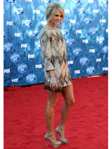 "If you've got great gams, show them off in a sexy mini. And for the fall season, balance out the shorter skirt length with longer sleeves—the style looks modern and it'll keep you at least a <i>little</i> warmer in the cool weather. We love how Carrie Underwood was perfectly proportioned in this <a href=""http://lorenasarbu.com/#awp::collections/pre-fall-2011""target=""_blank"">Lorena Sarbu</a> version."