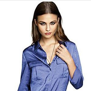 A pretty blouse in a bold hue like blue, purple or red can be worn buttoned-up at the office or sexed-up for a hot date.
