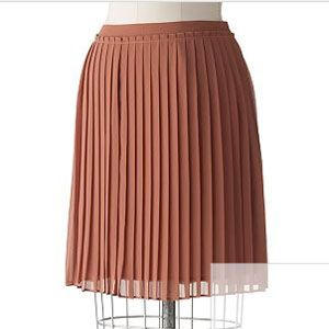 If you need a new skirt that you can wear with anything, try a pretty, ladylike pleated version in a sexy length.