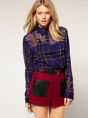 """This shirt is the exact opposite of your boyfriend's plaid: It's sheer, sexy and so right for the season. <br /><br />  Motel Laurel Tartan Sheer Chiffon Shirt, $69.52, <a href=""""http://us.asos.com/Motel/Motel-Laurel-Tartan-Sheer-Chiffon-Shirt/Prod/pgeproduct.aspx?iid=1668479&cid=2623&Rf-800=-1,57.393&sh=0&pge=0&pgesize=20&sort=-1&clr=Royaltartan""""target=""""_blank"""">us.asos.com</a>"""