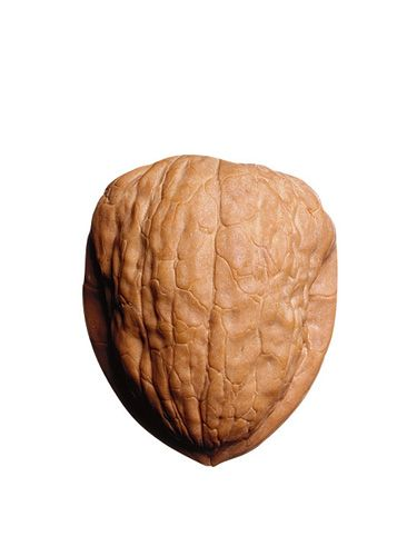 """We love a weight loss tip that calls for noshing on fatty delicious food. In a small-scale study, researchers at Beth Israel Deaconess Medical Center, a hospital in Boston affiliated with Harvard Medical School, found that when subjects ate walnuts at breakfast, they <a href=""""http://www.cosmopolitan.com/celebrity/news/nuts-help-with-weight-loss-harvard-study"""" target=""""_blank"""">felt more satiated</a> than those who didn't snack on nuts. In fact, the walnuts were so filling that hours later, at lunch time the people in the study reported still feeling full. That's partly because nuts don't have carbs, which tend to cause surges in blood sugar. Without going into the whole scientific explanation, when blood sugar levels spike, it sends a message to our bodies that we should start storing fat. This leads to packing on pounds and, in some extreme cases, the onset of diabetes."""