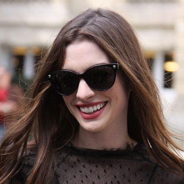 This style looks good on most face shapes, but it's super-flattering if your face is round. Here, the black frames complement Anne Hathaway's porcelain skin.
