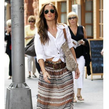 We love the maxi skirt, wide belt, and wedges, but it's the simple knot in her shirt that makes Minka Kelly's laid back style spot-on. It's an easy way to show some skin, stay cool and look sexy—but not like you're trying too hard.