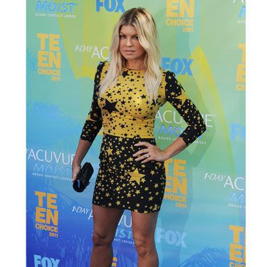 The star wore stars—in the form of a very cool black and yellow Dolce & Gabbana mini dress.
