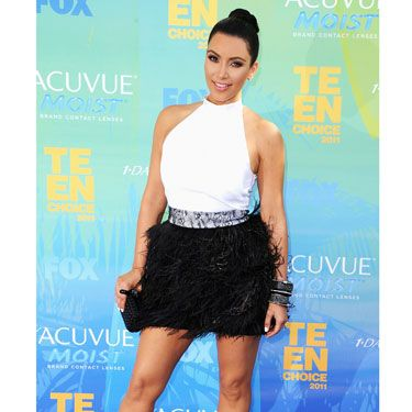 Kim pulled her signature mane back into a tight bun to show off her shoulder-baring Givenchy dress.