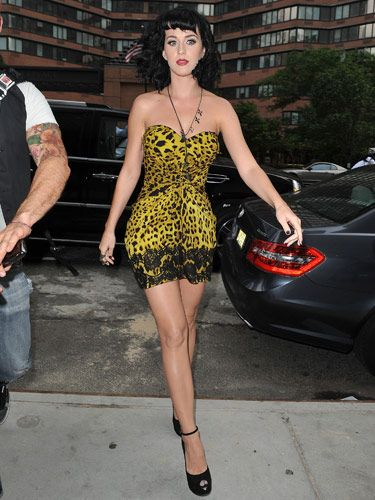 """After Katy wore this neon yellow mini out and about in NYC last June, her <a href=""""http://www.cosmopolitan.com/celebrity/style/Star-Style-Evolution-Katy-Perry"""">style started to evolve</a> from ladylike to edgy.  <br /><br /> <b>Look-Sexy Tip:</b> Wear a bold print to a big event and feel like you've made a full-on transformation."""