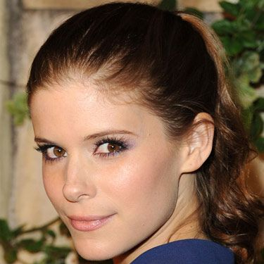 The smoky-eye look is always in style. Forget boring black and try it in a jewel tone like Kate Mara's purple version.