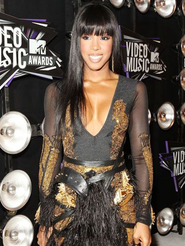 No, this isn't a Kelly Rowland wax statue. Her twins are really that flawless.