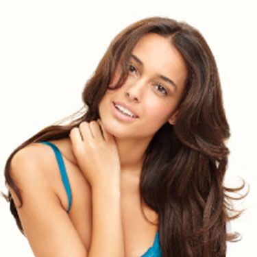 She might not be ready to jump you, but if she's relaxed, it won't take much to get her there. First, slowly pull her close, so that she's leaning against your chest. The warmth of your body against hers will cause her 