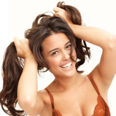 When a woman is feeling goofy, she wants you to be playful with her as well. If that sounds like an invitation to get hands-on, that's because it is. Start by tickling her or by giving her a flirty spank. Your goal: Get physical while keeping her laughing, because humor is an awesome aphrodisiac. Once you have her giggling, take the flirting up a notch by grabbing her by the butt and pulling her toward your hips. The motion simulates sex, which will kick those naughty thoughts into gear.