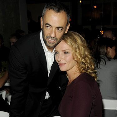 Uma Thurman took a moment to cuddle up with Calvin Klein designer Francisco Costa.