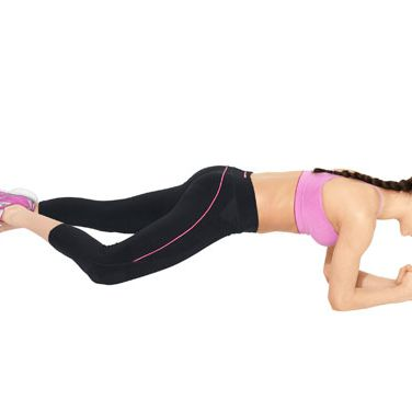 <b>Step 1:</b> Start in a plank: knees off the floor, legs and back straight, belly pulled in. Bend your right leg (knee facing the side, toes pointed), and place your right ankle behind your left.