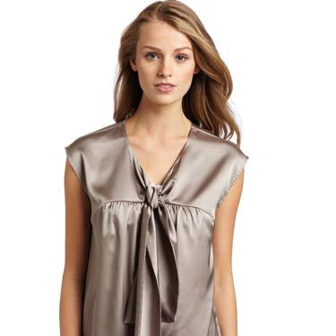 """We love this top because it's festive and flirty without being <i>too</i> sexy.<br /><br />Mac & Jac Women's Matte Satin Blouse, $69, <a href=""""http://www.amazon.com/Mac-Jac-Womens-Blouse-Medium/dp/B0057TWVMO/ref=sr_1_11?s=apparel&ie=UTF8&qid=1320962264&sr=1-11""""target=""""_blank"""">amazon.com</a>"""
