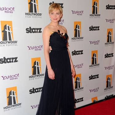At the same event, Michelle Williams wore a black Nina Ricci gown that was also beautifully sheer.