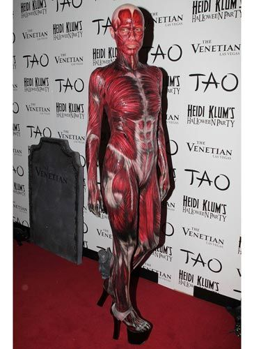Though you may not be able to recognize the supermodel, this really is Heidi—she goes over the top every year. Do you think she was trying to make a statement about beauty being skin-deep? (Or are we reading <i>way</i> too much into this gory costume?)
