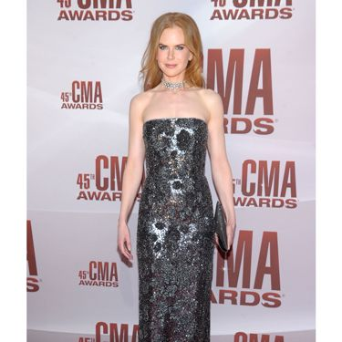 The star hit the CMA Awards to support hubby Keith Urban wearing a silvery-gunmetal Jean Paul Gaultier gown.