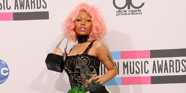 """Normally, when a star plans to change into something wild and crazy mid-show, she balances that by starting off in a slightly more under-the-radar dress. The singer—and <a href=""""http://www.cosmopolitan.com/celebrity/exclusive/nicki-minaj-cosmo-cover-girl-november-2011"""" target=""""_blank"""">November Cosmo cover girl</a>—has never heard the phrase """"under the radar"""" and that's why we love her."""