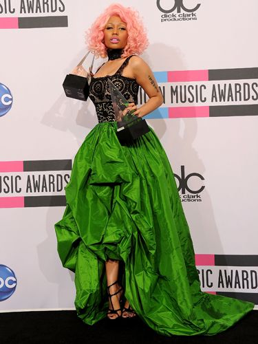 "Normally, when a star plans to change into something wild and crazy mid-show, she balances that by starting off in a slightly more under-the-radar dress. The singer—and <a href=""http://www.cosmopolitan.com/celebrity/exclusive/nicki-minaj-cosmo-cover-girl-november-2011"" target=""_blank"">November Cosmo cover girl</a>—has never heard the phrase ""under the radar"" and that's why we love her."