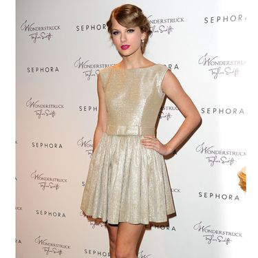The singer wore shimmer from head to toe in a pretty party dress and metallic heels.