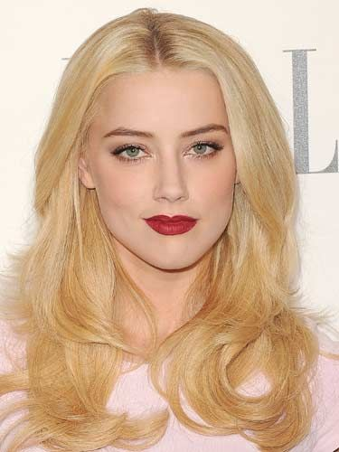 Platinum-haired Amber Heard loves to go light on the makeup but bold on the
