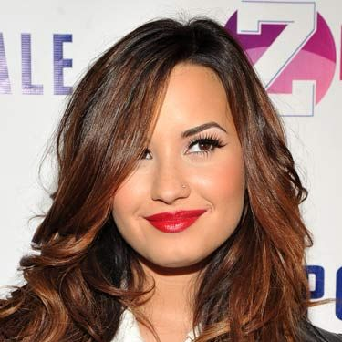 Lipstick looks fab with simple separates. Here, Demi Lovato pairs a crimson pout with a white button down and a leather jacket.