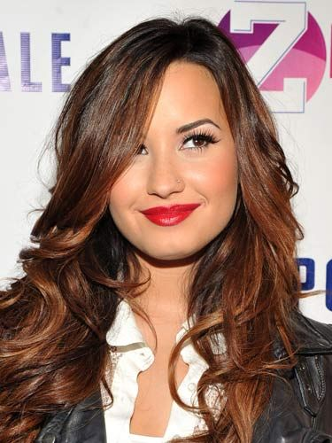 Lipstick looks fab with simple separates. Here, Demi Lovato pairs a crimson pout with a white button down and a leather jacket. <br /><br /> <b>Colors to try:</b> Rich ruby to raspberry.