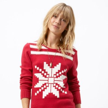 A sweater with just one jumbo image—like a snowflake or a reindeer—can be surprisingly chic.