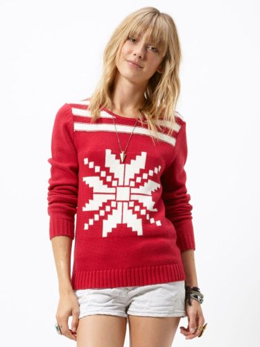 """A sweater with just one jumbo image—like a snowflake or a reindeer—can be surprisingly chic.<br /><br />Alpine Sweater, $59.50, <a href=""""http://www.roxy.com/product/index.jsp?productId=11697193""""target=""""_blank"""">roxy.com</a>"""