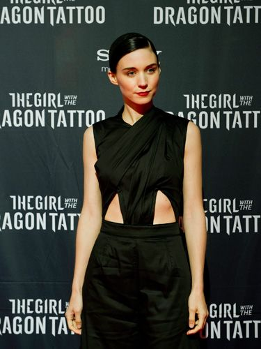 In Sweden, where the book is set, Rooney wore another cut-out dress except this one was black and simple.
