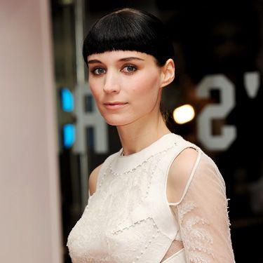 At the first showing of the film, Rooney Mara opted to wear a white, cut-out gown. And she showed off the dark hair hue and short bangs she got for the role.