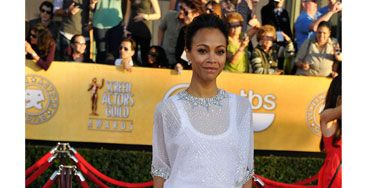 """We picked her as one of our <a href=""""http://www.cosmopolitan.com/celebrity/exclusive/fun-fearless-females-2012-zoe-saldana"""" target=""""_blank"""">2012 Fun, Fearless Female honorees</a> for more than her fashion sense, but the <i>Colombiana</i> star proved she can hold her own on the red carpet in a stunning Givenchy Haute Couture dress."""