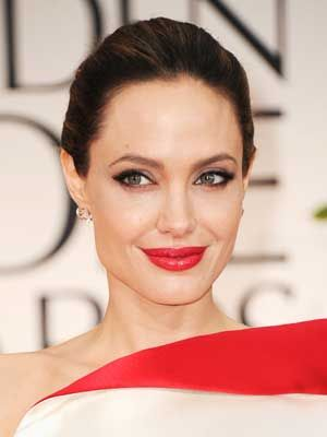 This sleek hairstyle and bold red lip is classic and modern at the same time.