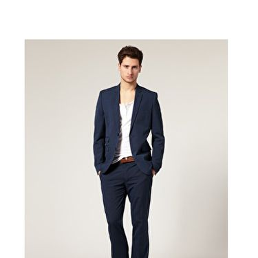 """Just like women have the little black dress, men have the navy blazer. A fitted single-breasted, <a href=""""http://www.askmen.com/fashion/fashiontip_400/440_two-button-or-three-button-suit.html"""" target=""""_blank"""">two-button blazer</a> with a notched lapel has the power to transform an otherwise ho-hum office-shirt-and-tie combo into something dapper. <br /><br />Bonus:  He'll be able to wear this with everything from jeans to, well, those office-shirt-and-tie combos.<br /><br />ASOS Slim Fit Blue Suit Jacket, $118.17<br /><a href=""""http://us.asos.com/Baku-Hipster-Pant-With-Sliders/tfov0/?sgid=3078&cid=5678&Rf900=1494&Rf-200=3&sh=0&pge=0&pgesize=20&sort=-1&clr=Blue&mporgp=L0FTT1MtU2xpbS1GaXQtQmx1ZS1TdWl0LS8"""" target=""""_blank"""">asos.com</a>"""
