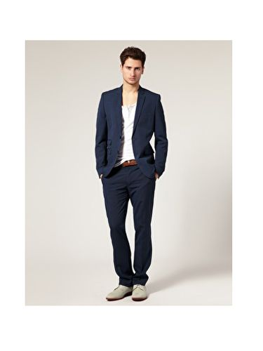 "Just like women have the little black dress, men have the navy blazer. A fitted single-breasted, <a href=""http://www.askmen.com/fashion/fashiontip_400/440_two-button-or-three-button-suit.html"" target=""_blank"">two-button blazer</a> with a notched lapel has the power to transform an otherwise ho-hum office-shirt-and-tie combo into something dapper.  <br /><br /> Bonus:  He'll be able to wear this with everything from jeans to, well, those office-shirt-and-tie combos.<br /><br /> ASOS Slim Fit Blue Suit Jacket, $118.17 <br /> <a href=""http://us.asos.com/Baku-Hipster-Pant-With-Sliders/tfov0/?sgid=3078&cid=5678&Rf900=1494&Rf-200=3&sh=0&pge=0&pgesize=20&sort=-1&clr=Blue&mporgp=L0FTT1MtU2xpbS1GaXQtQmx1ZS1TdWl0LS8"" target=""_blank"">asos.com</a>"