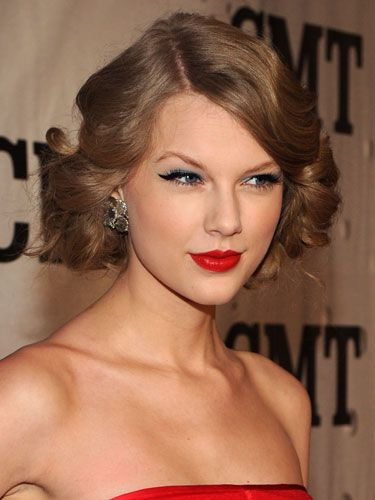 The sweet Southern crooner always looks amazing when she flaunts her natural wavy texture. All that blond hair could be a lot to pull off, especially with such a slight frame, but Taylor works it. This pulled-back look she rocked on a November red carpet is a total winner; sleek and sophisticated, but with lots of body.
