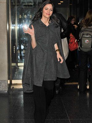 <i>Smash</i> star Katharine McPhee recently stepped out in a cape, a trend we're totally loving for the transition from winter to spring since the look works on all body types. <br /><br /> If you want to try it, keep in mind that wearing bulky clothing underneath (a fluffy sweater or wide-legged pants) can look messy and unflattering. <br /><br /> Think in terms of long lines with a fitted top and skinny jeans, or a mini with solid tights. If your cape is monochromatic, feel free to add some patterns with your clothes. If it's a little loud, like a plaid or stripes, it's best to stick with solids elsewhere.  <br /><br /> The look is super chic and versatile—you can work it everywhere from work to Sunday brunch with your girls. <br /><br /> We like these...