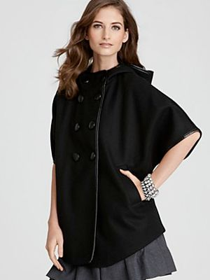 """DKNY Double-Breasted Cape Coat, $187 <a href=""""http://www1.bloomingdales.com/shop/product/dkny-double-breasted-cape-coat?ID=571308&cm_mmc=Froogle_pla_pe-_-adtype-pla-_-target-34094254024-_-kw-&gclid=CPKDxYPGnq4CFUG_3godKHiO3w"""" target=""""_blank"""">bloomingdales.com</a>"""